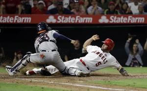 Pujols' 3 hits, 3 RBIs power streaking Halos past Astros 9-6
