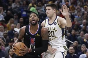 George silences boos as Clippers hold off Pacers 110-99