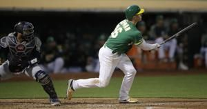 Chapman homers, drives in 5 as A's beat Mariners 9-2