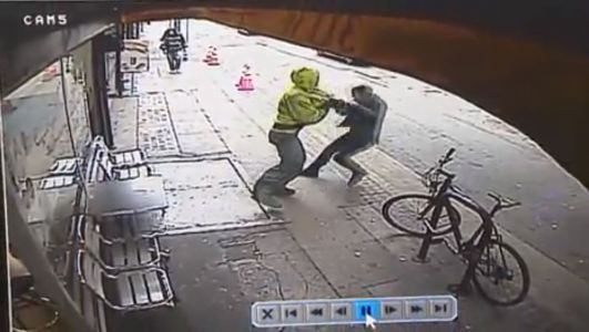 Terrifying video: Man shoved into oncoming traffic, pinned under truck