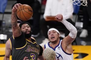 Anthony Davis' clutch block helps Lakers beat Nuggets to snap three-game losing streak