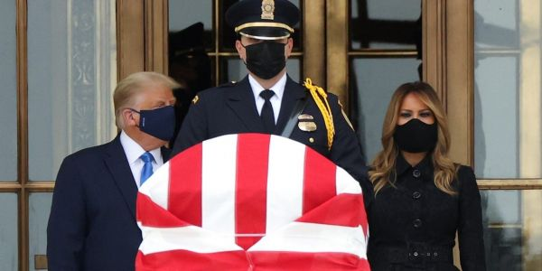 Trump and Melania booed, greeted with 'vote him out' and 'honor her wish' chants as they visited Ruth Bader Ginsburg's casket at the Supreme Court