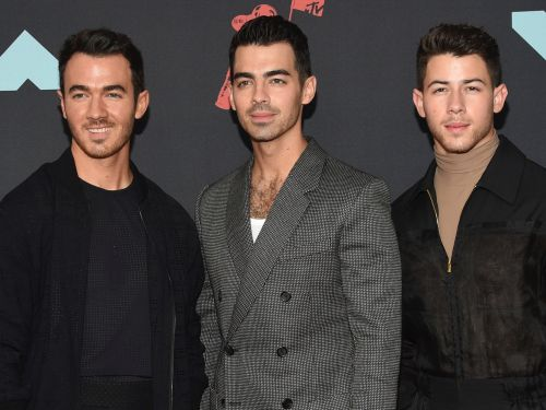 Watch the Jonas Brothers and their wives pay tribute to 'Grease,' 'Risky Business' and more iconic movies in their newest music video