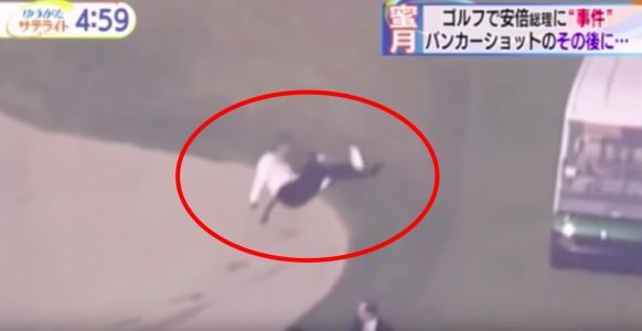 Japan's prime minister fell over and rolled into a bunker while playing golf with Trump