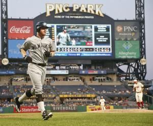 Bell's 4 hits send Pirates over Brewers 7-3