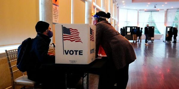 Just over half of Americans believe voting is a 'fundamental right' as states pass legislation tightening ballot access, Pew poll shows