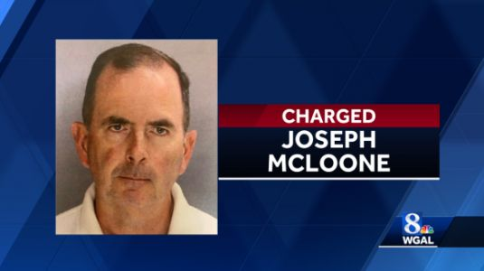 Priest charged with stealing nearly $100,000 from church
