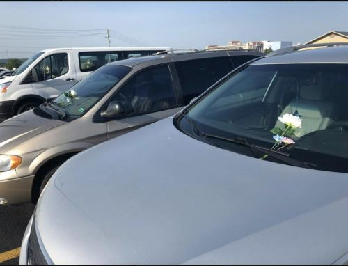 People leaving flowers, stuffed animals on cars left behind by Ride the Ducks victims