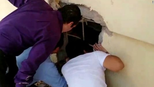 Moment kids found alive in collapsed school