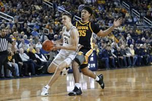 No. 4 Michigan tops Iowa 103-91 despite 44 points from Garza