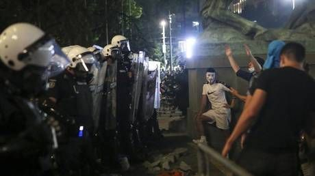 Serbian police arrest 71 protesters, including Brit, as mayhem over Covid-19 restrictions continues