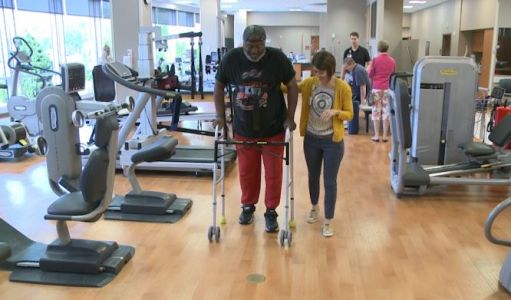 'Quitters never win': Football coach paralyzed after fall walks again