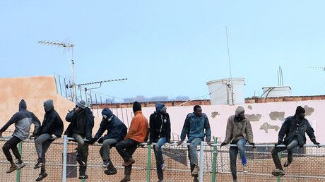 1 killed as hundreds of migrants storm barrier between Spain and North Africa