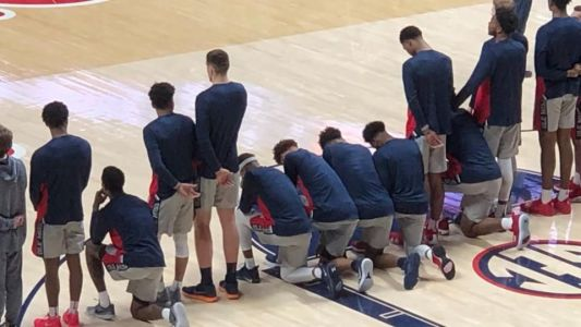 Mississippi basketball players kneel during anthem in response to Confederate rally