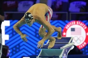 Unvaccinated US swimmer sparks debate as Olympics start