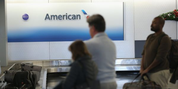 American Airlines threatens to make people pay for a whole new flight if they want to change the time