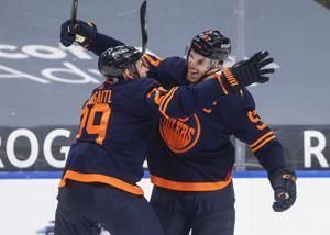 McDavid reaches 100 points, Oilers beat Canucks 4-3
