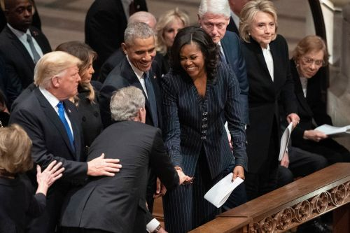 Trump takes seat with living presidents club at Bush's funeral