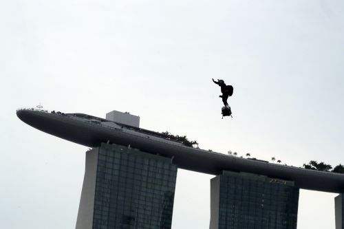 A man flew through the air on a jet-powered hoverboard during the Singapore Grand Prix