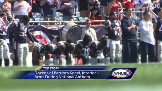 Dozens of Patriots kneel, link arms during national anthem