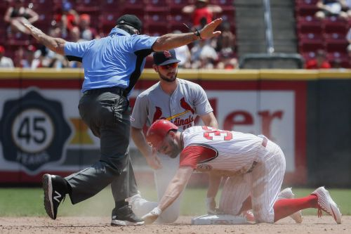 Munoz hitting, Gallegos relief lead Cards to win over Reds 3-1