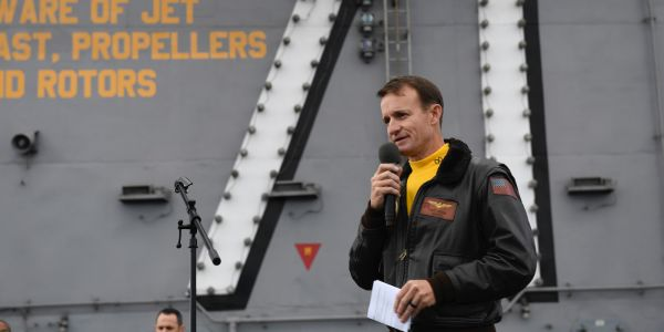 The acting Navy secretary says he swiftly fired an aircraft carrier captain to avoid having Trump step in