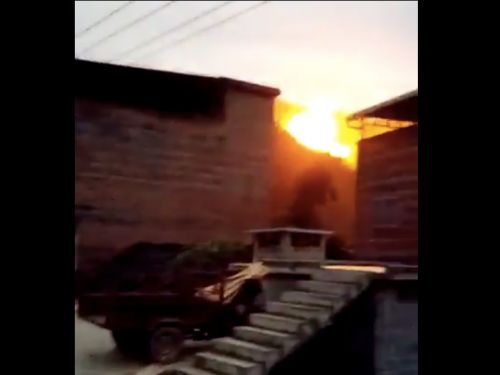 Video shows massive explosion as rocket debris from a Chinese space launch crashes down near houses