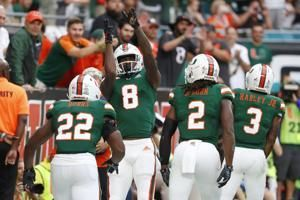 Williams sets Miami mark, Canes top Louisville 52-27
