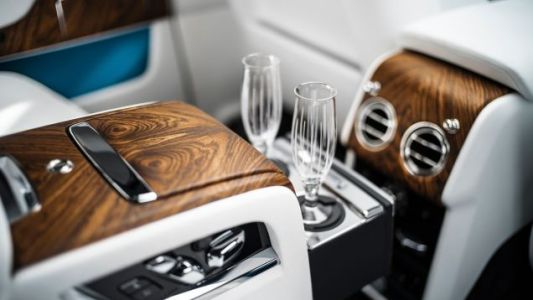 BMW Patents Bottoms-Up Drink Filler So You Can Drink Even When the Chauffeur Picks Lousy Roads