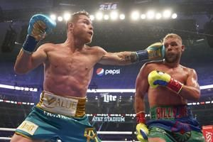 Alvarez adds another title with 8th-round TKO of Saunders