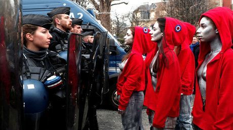 Bare-breasted, silver-painted 'Mariannes' confront police in Paris