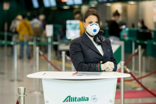 Italy bans use of overhead storage compartments on certain flights to reduce crowding and coronavirus exposure