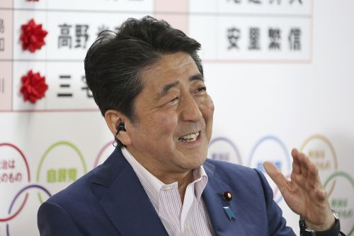 Japan's ruling coalition scores election triumph