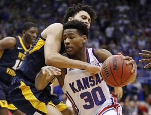 Dotson, Lawson brothers lead No. 14 Kansas' rout of WVU