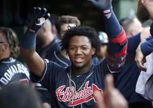 Albies, Acuña hit homers to lead Braves past Cubs 3-2