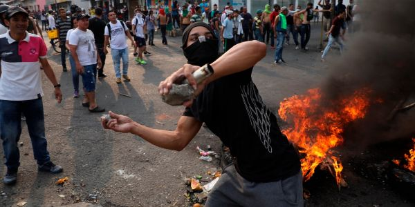 Photos show chaos in Venezuela as protesters and soldiers clash over humanitarian aid shipments