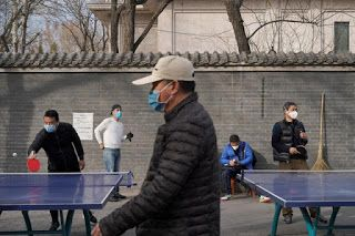 China reports fall in new coronavirus cases but concerns grow over rising global spread