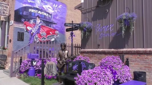 A town made famous by 'Purple Rain' unveils a life-sized statue of Prince