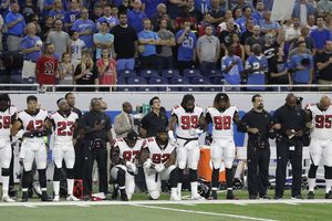 More than 200 NFL players sit or kneel during anthem