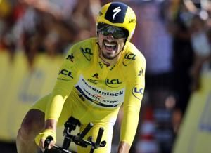 Alaphilippe stuns Tour with time-trial win, builds race lead