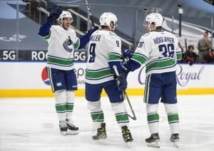 Canucks stop 6-game skid with 6-3 victory over Oilers