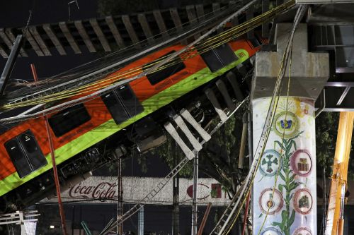 At least 20 killed after Mexico City metro overpass collapses onto road