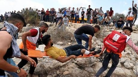 Over 140 Palestinians injured as Israeli forces use rubber bullets and tear gas to break up West Bank protest