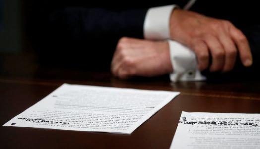 Trump read from a typed script to claim he misspoke in his press conference with Putin, with a handwritten note: 'THERE WAS NO COLUSION'