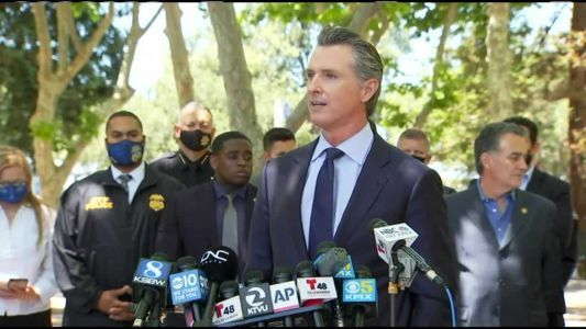 Gov. Newsom visits Seaside vaccine clinic, hands out gift cards