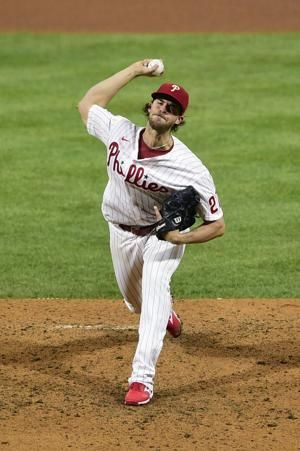 McCutchen hits 2 solo homers, Phillies beat Brewers 6-5