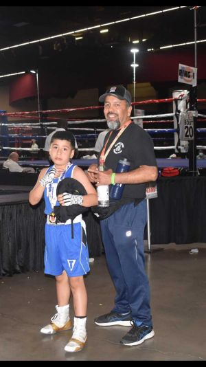 8-year old boxing champ brings home the gold from the National Junior Olympics