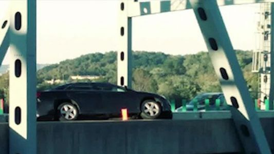 Woman's car nearly pushed off Combs-Hehl bridge after being rear-ended
