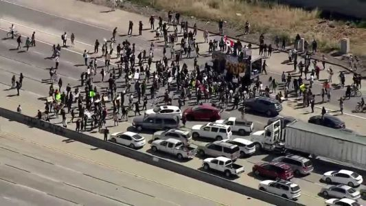 Hundreds block Silicon Valley highway over Floyd killing