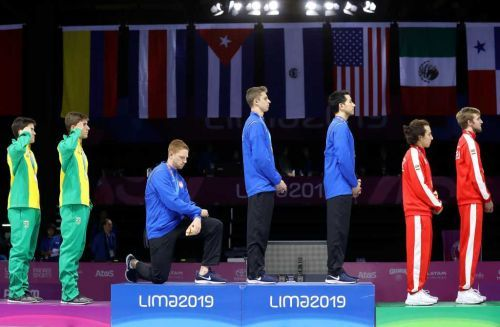 American gold medalist kneels during national anthem at the Pan Am Games